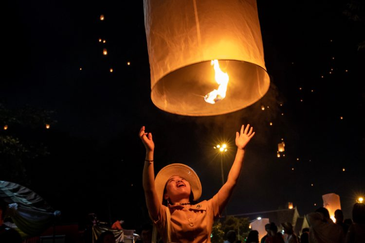 Chinese woman releasing lantern to the sky